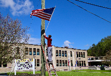 American flags fly in South Otselic
