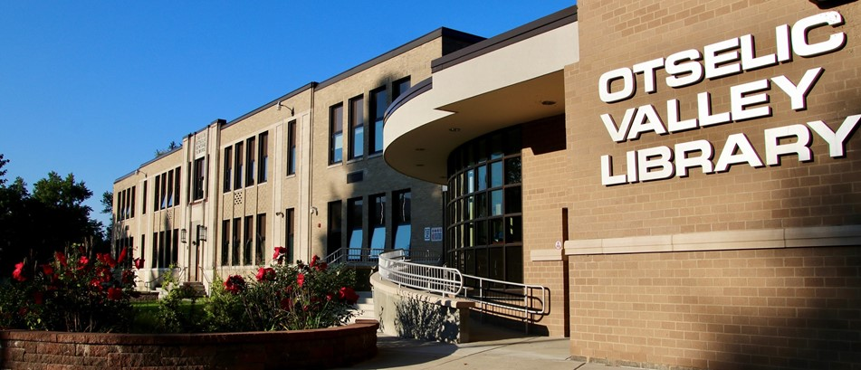 front of school building with library sign
