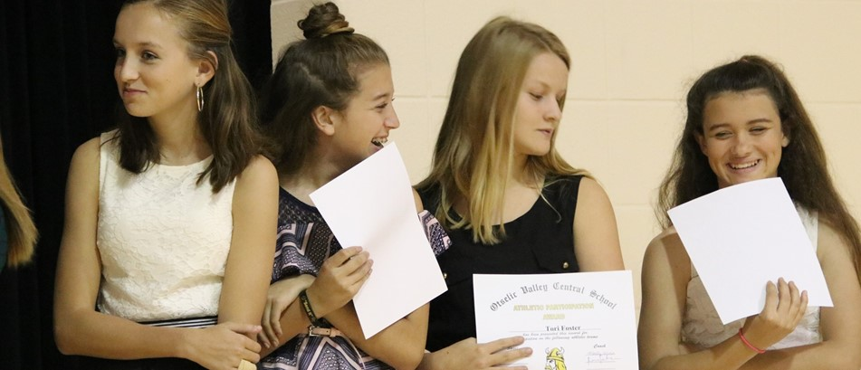 4 girls hold certificates