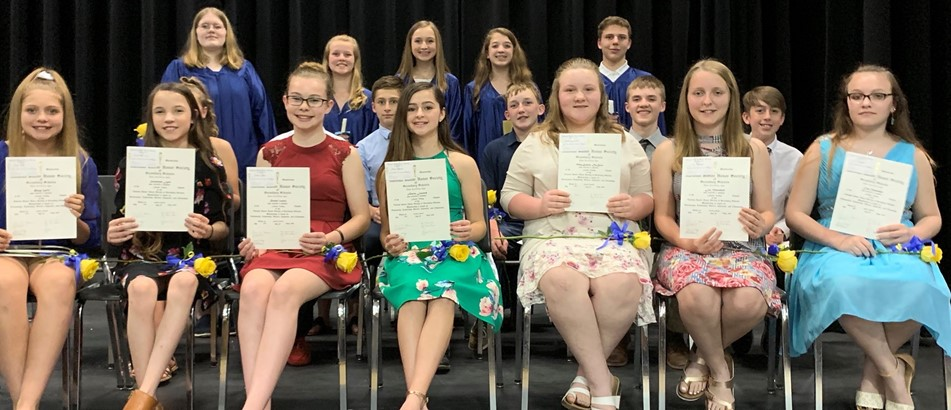 3 rows f smiling teens hold certificates