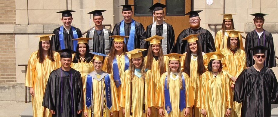 3 rows of smiling students in gold and black high school graduation caps and gowns
